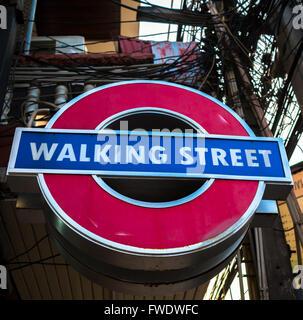 Walking street sign, Pattaya, popular tourist attraction in Thailand - Stock Photo
