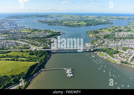 An aerial view of the Tamar Estuary with the road and railway bridges visible - Stock Photo