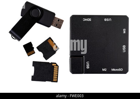 Top view of black plastic square USB hub, memory stick and card adapters. - Stock Photo