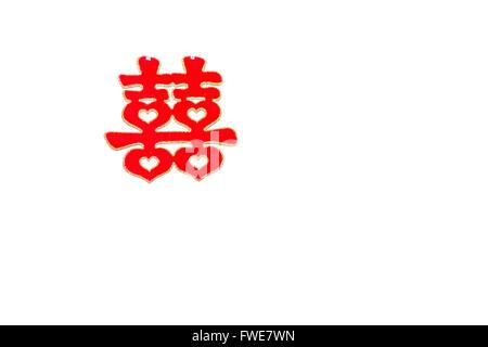 Traditional Chinese wedding decor symbolizing happiness and luck on white background. - Stock Photo