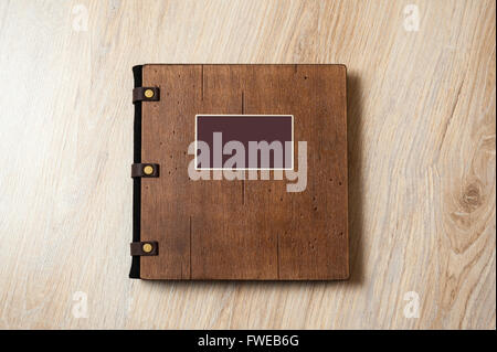 wedding book with wooden cover on a texture. - Stock Photo