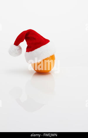 Orange with Christmas Hat - Stock Photo