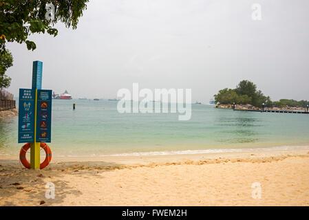 Palawan Beach on Sentosa Island fun park in Singapore - Stock Photo