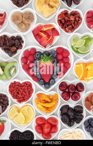 Health and fruit super food selection in heart shaped porcelain dishes. High in vitamins and antioxidants. - Stock Photo