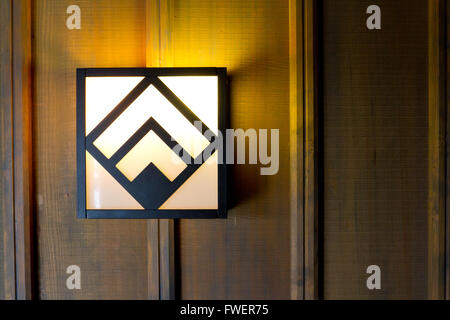 Historic Timberline lodge light fixtures on an old wooden wall in a hallway. - Stock Photo