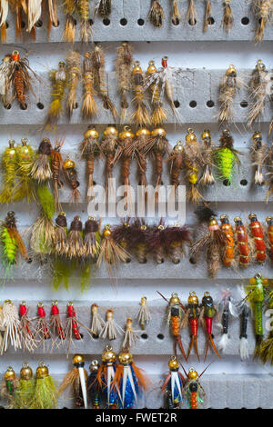 Nymphs and streamers are in this fly fishing box showing the variety of flies used to catch fish in this recreational - Stock Photo