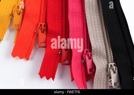 Colorful Zippers in six different colors on white background. - Stock Photo