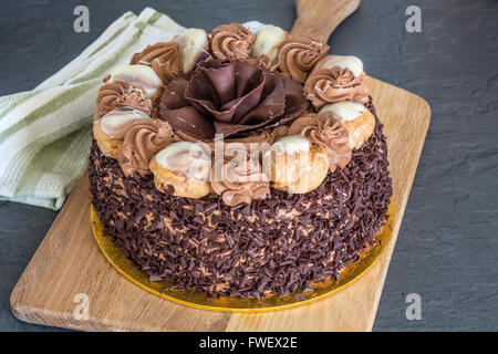 Large Chocolate cake with profiteroles - Stock Photo