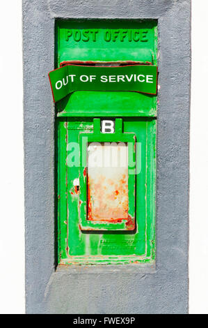 Green Irish An Post postbox, with 'Out of Service' sign across the letterbox. - Stock Photo