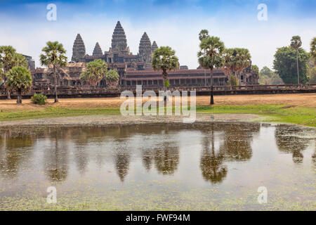 PEOPLE at the entrance to Angkor Wat temple in Cambodia UNESCO World Heritage Site, 7th Wonder of the World,Archaeological - Stock Photo