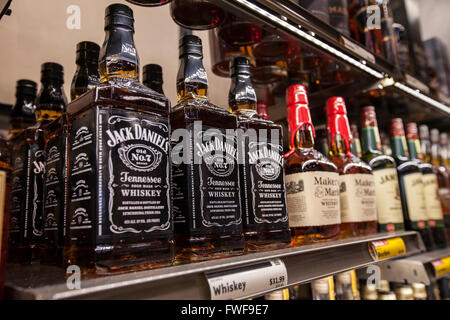 bottles of Jack Daniel's whiskey on a shelf at a store - Stock Photo