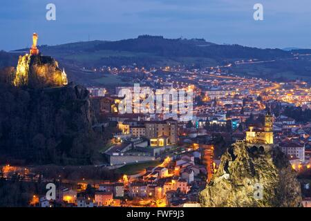 A colour image taken at dusk of the town of le puy-en-velay in france - Stock Photo