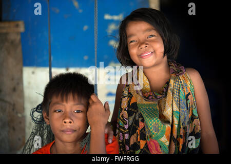 Portrait of two children. Fishing gypsy village. Koh Mook (Muk) is a small rocky island off the coast of Trang province. - Stock Photo