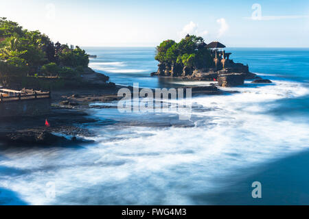 Pura Tanah Lot in the morning, famous ocean temple in Bali, Indonesia. - Stock Photo