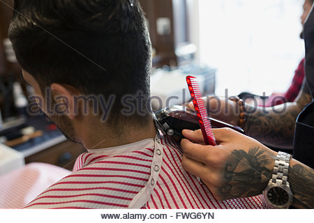Barber shaving man - Stock Photo