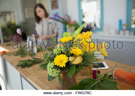 Yellow bouquet on counter in florist shop - Stock Photo