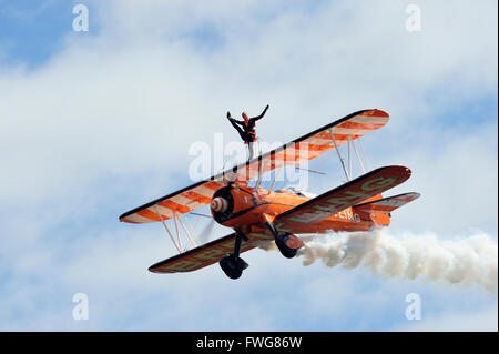 Breitling Wingwalkers aerobatic display team Boeing Stearman biplane at East Fortune Airshow 2011 - Stock Photo