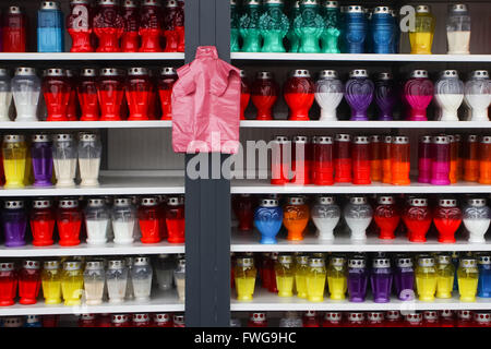 Lampions of different shapes and sizes for sale arranged in rows on shelves. - Stock Photo