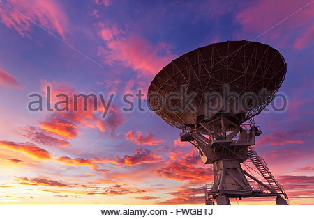 Radio Telescope at Very Large Array in Sunset near Soccoro, New Mexico - Stock Photo