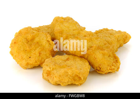 Fried chicken nuggets isolated on white background. - Stock Photo