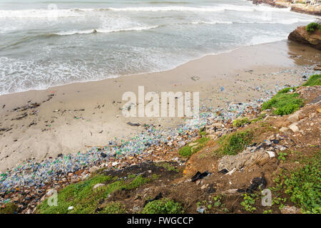 Very high pollution with beach full of plastic bottles - Stock Photo