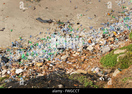 Very high pollution with beach full of plastic bottles. - Stock Photo