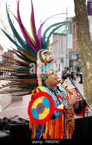 A Peruvian busker from South America playing music on the street, Broad Street, Reading Berkshire UK - Stock Photo