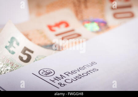 Inland Revenue tax letter with money - Stock Photo