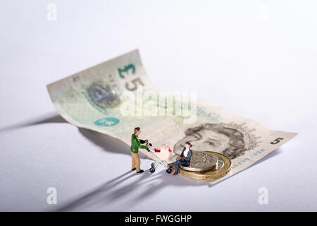 Photo of a family with seven pound twenty pence the new living wage for the UK - Stock Photo