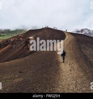 People Hiking On Mountains In Foggy Weather