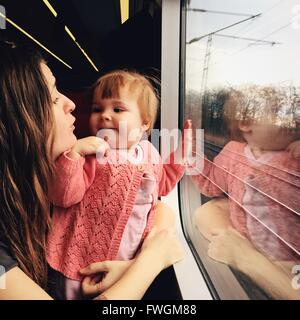 Baby With Mother In Train - Stock Photo