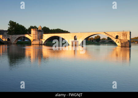 Bridge St. Benezet over Rhone River at sunrise, UNESCO, Avignon, Vaucluse, Provence-Alpes-Cote d'Azur, France - Stock Photo