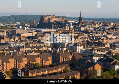 View from Holyrood Park over city rooftops to Edinburgh Castle, Edinburgh, City of Edinburgh, Scotland, United Kingdom, - Stock Photo