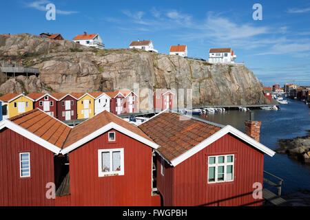 Traditional falu red fishermen's houses in harbour, Smogen, Bohuslan Coast, Southwest Sweden, Sweden, Scandinavia, - Stock Photo