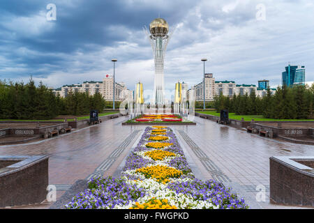 Nurzhol Bulvar, Central Boulevard and Bayterek Tower illuminated at night, Astana, Kazakhstan, Central Asia - Stock Photo