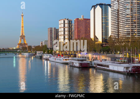 Night view of River Seine with high-rise buildings on the Left Bank, and Eiffel Tower, Paris, France, Europe - Stock Photo