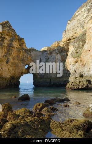 Weathered sandstone cliffs and sea stacks at Ponta da Piedade, Lagos, Algarve, Portugal - Stock Photo