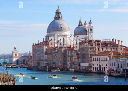 View of the 'Canal Grande' and the 'Santa Maria della Salute' church from 'Ponte dell'Accademia'. Venice, Veneto. - Stock Photo