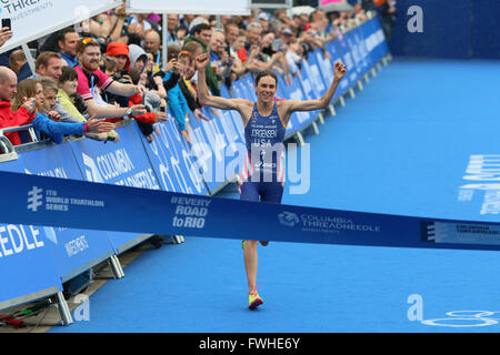 Leeds, UK. 12th June 2016. Gwen Jorgensen celebrates before crossing the line to take first place in the elite womens - Stock Photo