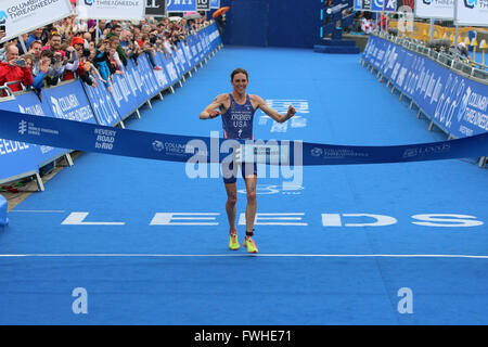 Leeds, UK. 12th June 2016. Gwen Jorgensen celebrates while crossing the line to take first place in the elite womens - Stock Photo