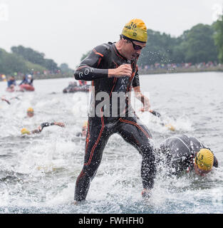 Leeds, UK. 12th June, 2016. Javier Gomez Noya of Spain  finishing the first lap of the open water swim in Roundhay - Stock Photo