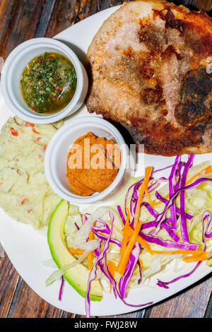 Grilled Pork With Mashed Potatoes, Honey Mustard And Chimichurri Sauce, Delicious Lunch - Stock Photo