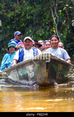 Cuyabeno, Ecuador - 20 March 2015: Group Of Happy European Biologists In The Canoe Crossing Cuyabeno River, South - Stock Photo