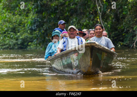 Cuyabeno, Ecuador - 20 March 2015: Group Of European Biologists In The Canoe Crossing Cuyabeno River, South America - Stock Photo
