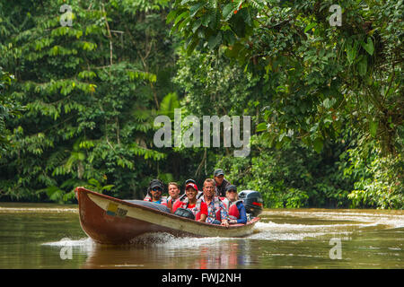 Cuyabeno, Ecuador - 20 March 2015: European Biologists In The Canoe Crossing Cuyabeno River Looking Straight Into - Stock Photo