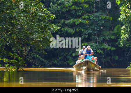 Cuyabeno, Ecuador - 20 March 2015: Happy European Biologists In The Canoe Crossing Cuyabeno River, South America - Stock Photo