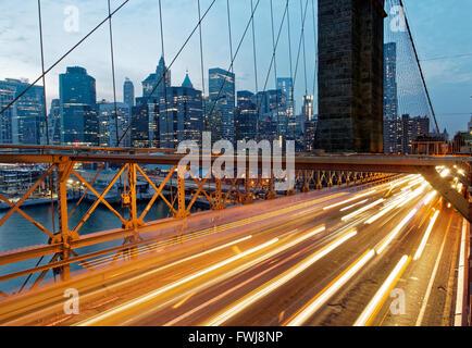 Light Trails On Brooklyn Bridge By Cityscape - Stock Photo