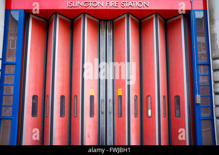 Red folding doors at Islington Fire Station, London - Stock Photo