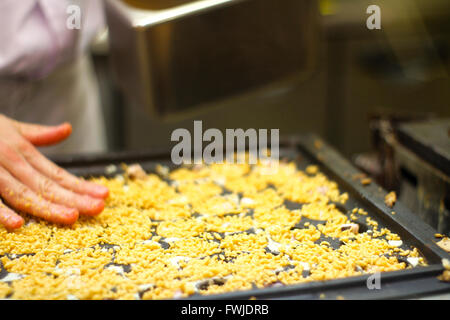 Person Making Okonomiyaki In Kitchen - Stock Photo