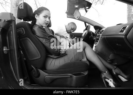 Portrait Of Beautiful Woman Sitting By Man In Car - Stock Photo